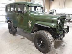 Willys Jeep Station Wagon, green military, black accents,  nose art, great updated wagon!