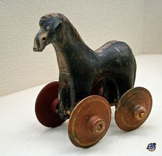 Little horse on wheels (Ancient Greek child's Toy). From tomb dating 950-900 BCE. Kerameikos Archaeological Museum - Athens