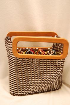 Soda tab bag with cherry wood handles. Can be purchased at Some Things Looming in Reading PA.