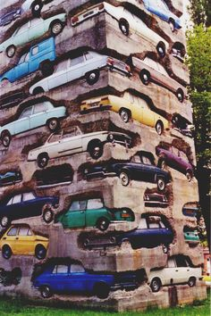 (Ron's garage). Long Term Parking, located at the Château de Montcel in France stands 60 ft high. Cars set in 40,000 pounds of concrete. Created in 1982 by Armand Pierre Fernandez.