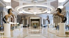 The Ritz-Carlton, Riyadh lobby Accented by four bronze horse statues, glimmering marble and a vaulted ceiling, the lobby offers guests a truly grand welcome