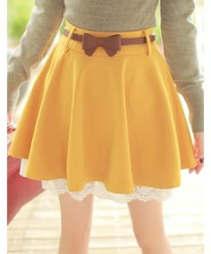 Such a cute two-layered skirt, tied with a bow belt and paired with a tucked in long sleeve shirt!