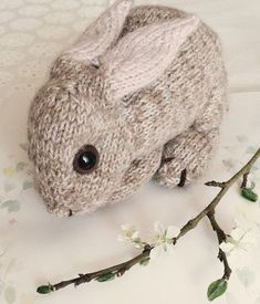 Knitting Pattern for Baby Bunny - Life-size baby bunny toy lies 20cm/ 8in long (tip of nose to tail). Knit flat and joined as you go. Designed by DotpebblesKnits