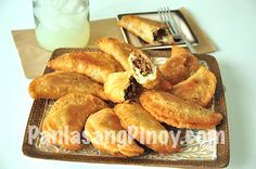 Fried Beef Empanadas with paprika, raisins, and green peas in a homemade flaky dough.