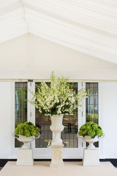 {green and white blooms and urns alter pieces}