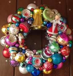 Beautiful wreath of vintage ornaments including large gold bell and vintage angel