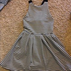 side medium striped summer dress! purchased from kohls (SO brand). criss crosses in the back. size medium, but also fits like a small- it is very snug. SO Dresses Mini