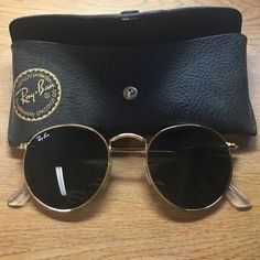 Ray-ban round glasses. Black and gold. Brand new Ray ban round sunglasses. Black lenses with gold frames. Never worn, brand new in original glasses case. Pricing is flexible! Ray-Ban Accessories Sunglasses