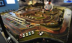 Slot Mods slot car tracks for the real motorhead man cave Slot cars are still around, though, with all of the radio control cars and trucks you see, you might not know it. Slot Cars, Slot Car Sets, Slot Car Racing, Slot Car Tracks, Race Cars, Race Tracks, Road Racing, Arcade, Pinup Art