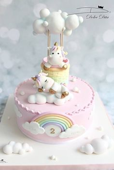 super cute unicorn birthday cake, pretty pink fondant with clever floating cloud decorations