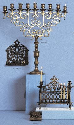 Polish branch-style menorah, circa 1890, probably graced a synagogue. Hanging - and bench - style menorahs were developed in the Middle Ages. During the Spanish Inquisition, the Jews known as Marranos concealed their menorahs in small travel