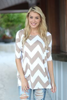 Get this Mocha Chevron Top from Saved By The Dress Boutique! Still hot this season chevron print is now in mocha and white. Short sleeve top for fashionistas