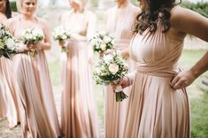 Seriously considering these.Two Birds bridesmaids dresses in blush. Two sizes, no alterations and let the girls choose which style they want to wear. Multiway Bridesmaid Dress, Two Birds Bridesmaid, Blue Bridesmaid Dresses Short, Bridesmaid Duties, Bridesmaid Flowers, Bridesmaids, Rose Gold Wedding Dress, Blush Wedding Flowers, Gold Wedding Theme