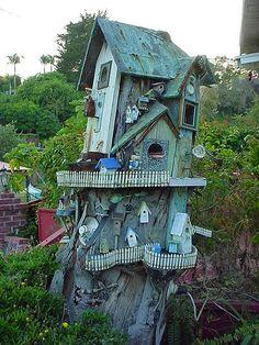 Tree stump birdhouse