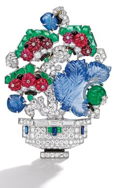 Platinum, Colored Stone, Diamond and Enamel Brooch, Mauboussin, France The potted flowering plant decorated with three carved sapphire leaves, accented by sugarloaf cabochon sapphires, carved ruby beads and carved emerald beads, further set with buff-top calibré-cut emeralds, completed by variously-cut diamonds weighing approximately 5.00 carats and applied with black enamel, signed Mauboussin, Made in France, numbered Y249, with French assay and workshop mark, one emerald missing; circa…