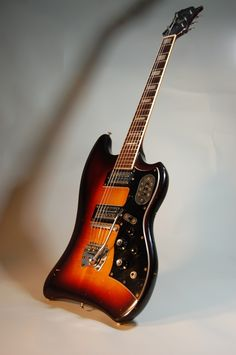 1963 Guild Thunderbird. Funky but cool guitar. Muddy Waters used one some and Dan from the Black Keys has recently started. Screams 60s