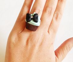 Tiffany Cupcake Cocktail Ring, Tiffany Blue cupcake topped with Black Bow, Adjustable Ring, Valentine's Day Gift, Teen Girls, polymer clay. $15.00, via Etsy.