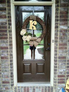 Grapevine wreath with hydrangeas and burlap ribbon