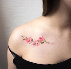Pink floral shoulder tattoo