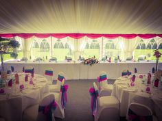 A long 'top' table against the marquee lawn creates a effective layout for the wedding breakfast.