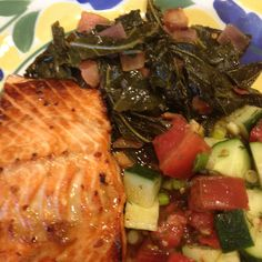 Soy and honey marinated salmon, collard greens with bacon, and cucumber tomato salad.