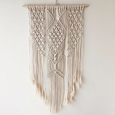 Medium macrame wall hanging made with pine dowel and 100% cotton braided cord.  Approx 60cm wide by 70cm length.  Other designs and options
