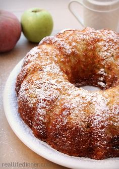 This Jewish Apple Cake Recipe is the most delicious Apple cake you will ever have. Grated Apples, Cinnamon baked in a bundt pan. Incredibly moist too. Köstliche Desserts, Delicious Desserts, Dessert Recipes, Cookie Recipes, Jewish Desserts, Food Cakes, Cupcake Cakes, Cupcakes, Comida Judaica
