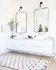 His and hers vanity and moroccan rug in Vanessa Alexander's master bath