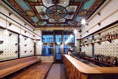 michael grzesiak transforms a century old butcher shop into a bar