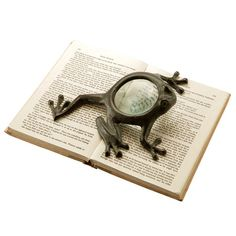 Cast iron magnifier with a frog design. Product: Magnifying glass Construction Material: Cast iron and glass Frog House, Frog And Toad, Magnifying Glass, Joss And Main, Decorative Objects, It Cast, Cast Iron, Whimsical, Cool Stuff