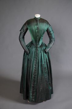 green silk 1840s dress restored by Shippensburg University Fashion Archives and Museum (SUFAM)    https://www.facebook.com/photo.php?fbid=493516750670720=a.138994706122928.18498.118377364851329=3=https%3A%2F%2Ffbcdn-sphotos-f-a.akamaihd.net%2Fhphotos-ak-snc6%2F221573_493516750670720_267749615_o.jpg=https%3A%2F%2Ffbcdn-sphotos-f-a.akamaihd.net%2Fhphotos-ak-snc7%2F479724_493516750670720_267749615_n.jpg=1072%2C712