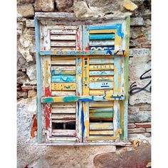 Colorful shutters in Chalkida (Photo by @grkapolas)