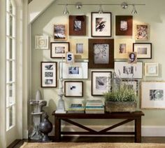 light green wall with wooden picture frame wall