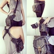 This is amazing. Steampunk style cross body, criss-cross chest and back, leg and hip attachment, with connected wallet.