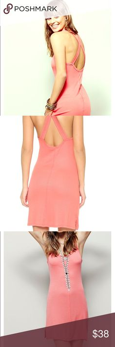 Brand NEW with Tag - Free People Slinky Tank Slip Brand NEW with Tag - Free People Slinky Tank Slip.  Size L.  Coral color.  Raised seams and raw trim with a scoop neckline.  Sexy low racerback with cutouts.  Sleeveless and unlined.  Rayon/spandex material. Free People Dresses Mini