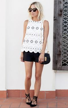 Damsel in Dior blogger wears a cut-out tank top, black shorts, black crossbody and lace-up ballet flats.