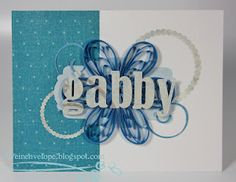 Personalized greeting card with quilled blue flower.