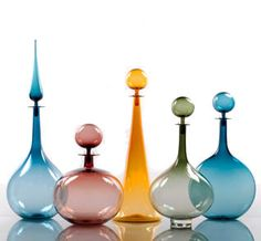Colored glass decanters can be used for display on a buffet or credenza Genie Bottle, Diy Bottle, Bottle Vase, Bottles And Jars, Glass Bottles, Perfume Bottles, Modern Tabletop, Apothecary Jars, Mosaic Glass
