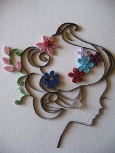 Girls silhouette done in quilling--very cute!!!  drb