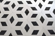 A floor pattern of white triangles with inset black, from a collaboration with Spanish architectCarme Pinós.