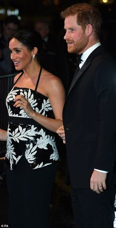 3971f84857f Meghan cradles her bump as she leaves Royal Variety Performance