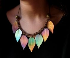 Made to order necklace, inspired of Autumn. Multicolored leaves, ancient gold end beads and cord. Bronce end caps and lobster claw clasp. Leaves sizes: 2,2 x 1,2 to 2 x 1. Weight: 20 gr. Length: 46 cm. For another length, please ask me.  Similar items... https://www.etsy.com/listing/88432755/polymer-clay-necklace-fall-leaves