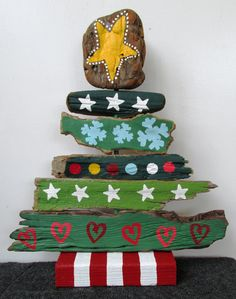 Painted Driftwood Christmas Tree by Peace Love Driftwood. Featured on CC: http://www.completely-coastal.com/2015/11/best-coastal-etsy-handmade-decor-usa.html
