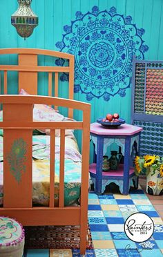 Annie Sloan Painter in Residence Janice Issitt used Chalk Paint® in Provence, Napoleonic Blue, Old White and Arles on the tiled floor of a bedroom to create a beautiful bright and bold, mediterranean look.