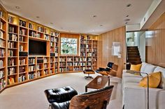 Library. Let's switch up the furniture, add some surround sound.. and voila. Perfect entertainment center!