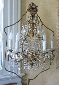 chandelier in a birdcage stand~a bunch of both~available at American Home & Garden in Ventura CA