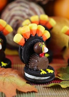 Candy turkey.  Stick candy corn into the center of one oreo for feathers, and using icing, glue that oreo (with the feathers on top) to another oreo.  Stick on a reeses peanut butter cup (with a slice taken off so it sits right), a whopper (for his head), and the white tip of a candy corn (for his nose).  Using colored icing add eyes, a gobbler, and feet.