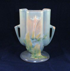 Here is a charming Roseville vase.
