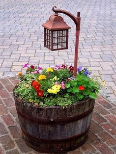 Add a solar light to your outdoor planter to creat...