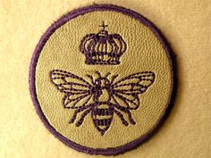 Mark yourself as The Queen Bee with this leather iron on patch mini. It measures 2.3 in diameter and is stitched in royal purple on silver cowhide